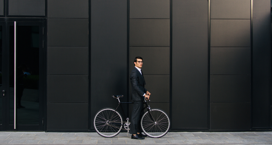 Businessman cycling in London