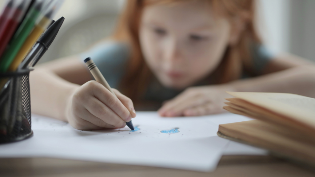 Child drawing on a paper