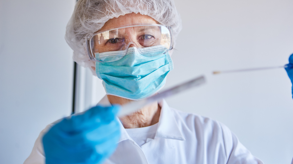 Doctor holding a covid-19 swab