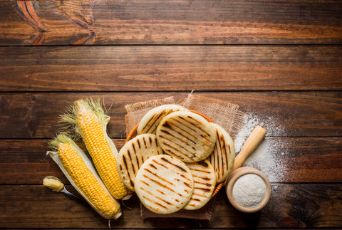 arepas ingredients are simple and gluten-free - masa harina, water, cheese, sugar, salt, butter