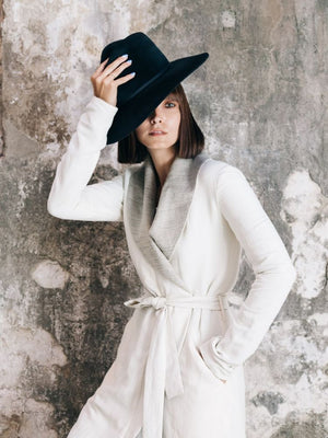 Ania B wearing white limited edition Lauren Bagliore coat
