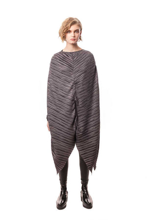 Oversized Pleated Poncho Dress. Wear it as a dress, overlay, or poncho. Featuring a cutting-edge silhouette, multiple styling options