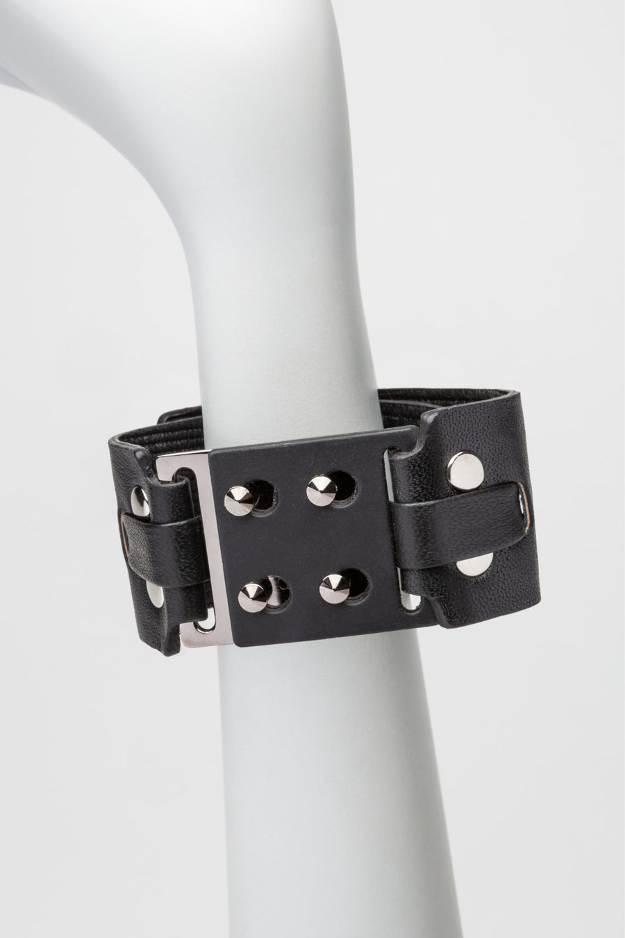 leather + metal cuff, with snap closure.