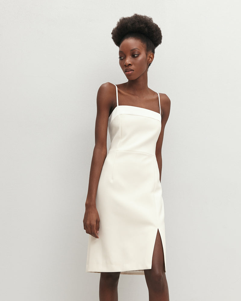 Milk-colored mini dress with a slit
