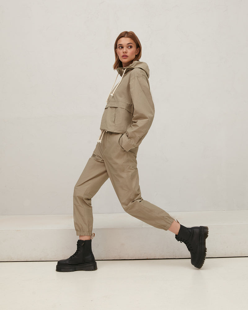 Olive-colored rustling trousers