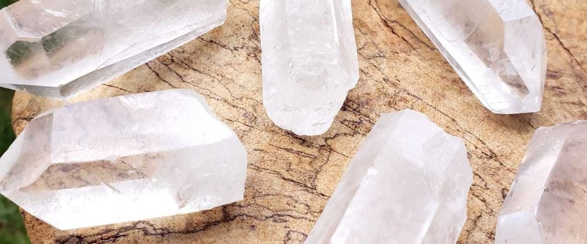 Several Clear Quartz Points on a tree stump