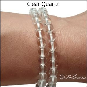 Two rows of clear quartz round gemstones wrapped around wrist