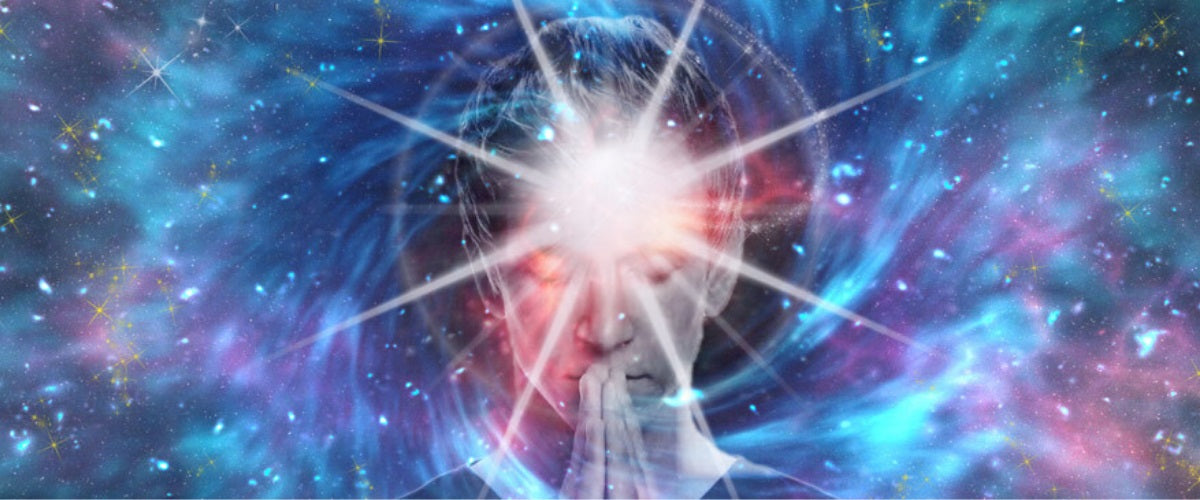 How Does Intuition Work Head part of a Person with eyes closed and a background like space