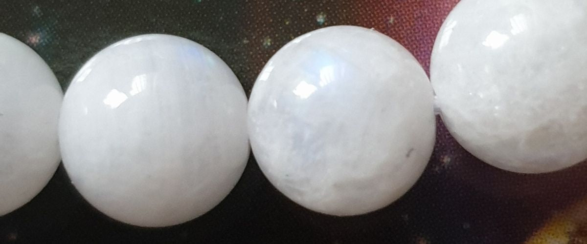 Close up of natural Rainbow Moonstones round gemstones