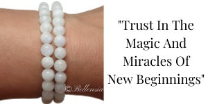 Moonstone 6mm Gemstones wrapped around wrist with a Quote to the side of image