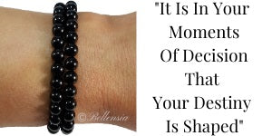 Onyx 6mm Round Gemstones wrapped around wrist with a Quote next to image