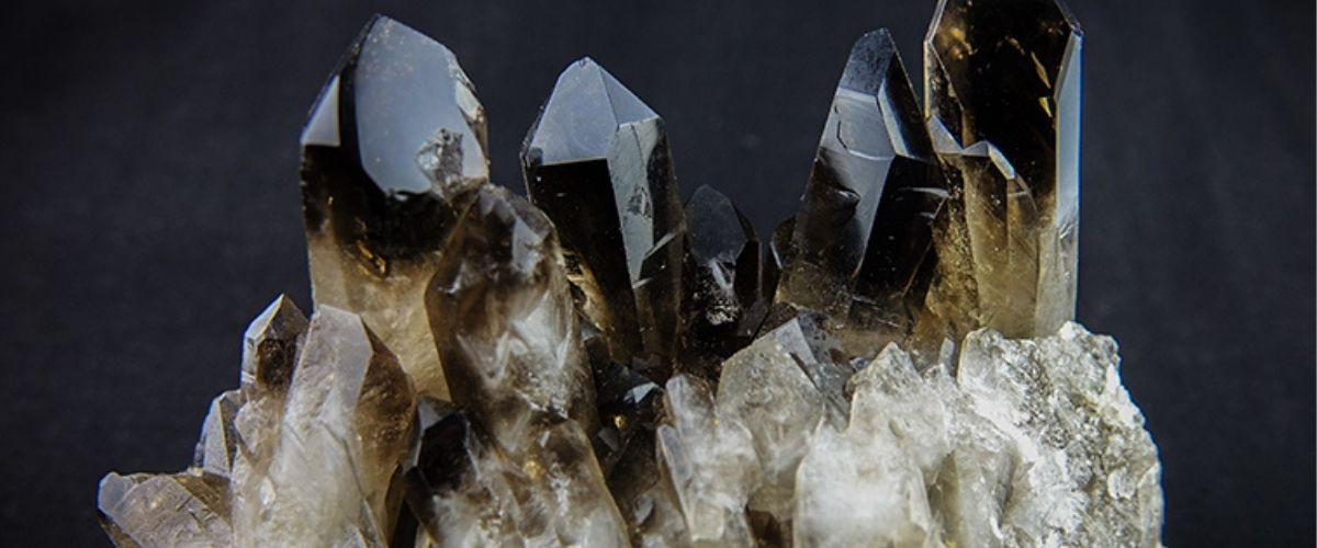 Stunning natural Smoky Quartz wand cluster still attached to its rock