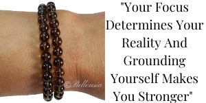 Smoky Quartz 6mm Round Gemstones wrapped around wrist with a quote to the right of image