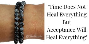 Snowflake Obsidian 6mm Gemstones wrapped around wrist with a quote to the right of image
