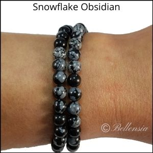 Two rows of snowflake obsidian round gemstones wrapped around wrist