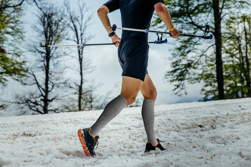 Man Running Wearing Grey Compression Socks