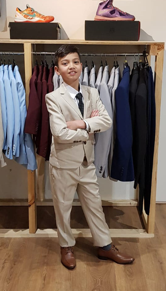 beige suit paired with brown shoes for holy communion