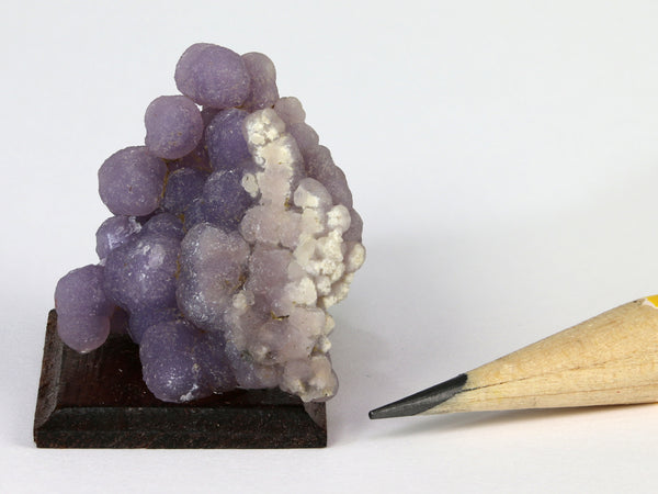Miniature mounted specimen of purple grape agate, Indonesia, side view