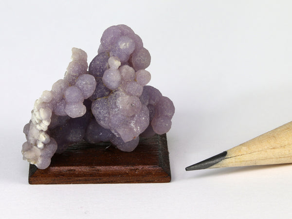 Miniature mounted specimen of purple grape agate, Indonesia, for dollhouses