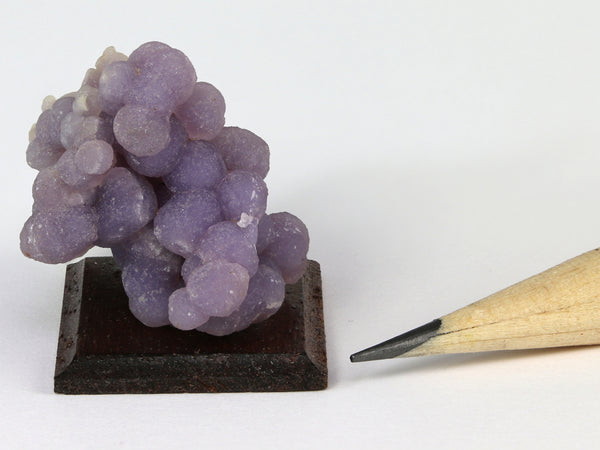 Miniature mounted specimen of purple grape agate, Indonesia. for dollhouses