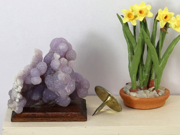 Small mounted specimen of purple grape agate, Indonesia., shown in 1:12 setting