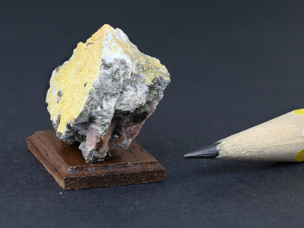 Dollshouse specimen of yellow vanadinite crystals, Ford Mine, Arizona.  Side view.