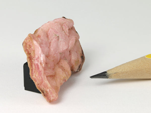 Pink rhodochrosite slab for a dollshouse scene, side view