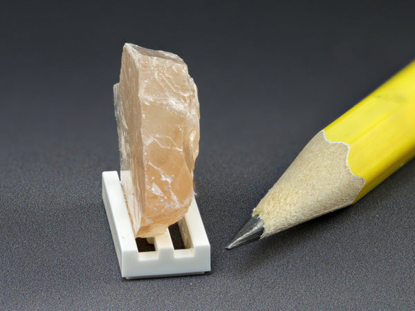 Orange calcite, Mexico.  Miniature display