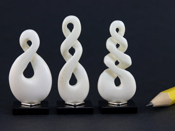 Carved bone helix - three designs