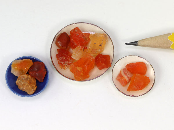 Tiny orange, red & yellow fire opal crystals in 1:12 scale china bowls.  Top view