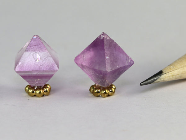 Pink or pale purple fluorite crystals, Illinois.  Miniature display.