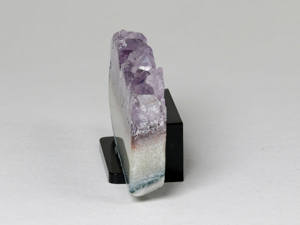 Dollhouse miniature amethyst crystal slab, side view.