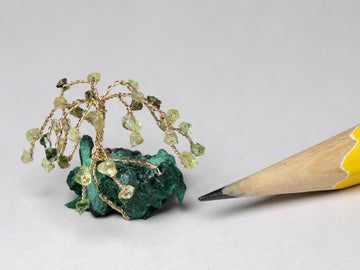 Peridot gem tree on malachite