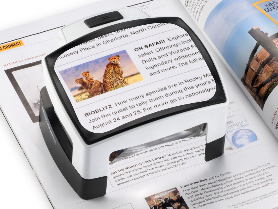 Visolux + on page, magnifying text and an image. Representing handheld and reading magnifiers