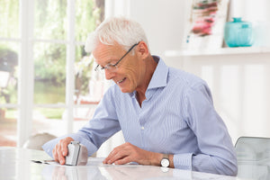 Man using segment magnifier to read