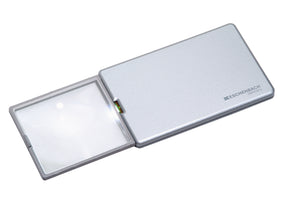 Rectangular magnifier with LED light, extended from silver casing.