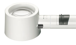 White, circular magnifier attached to battery handle