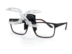 MaxDETAIL, double-lens magnifying system clip on for spectacle wearers, shown with frame and system raised.