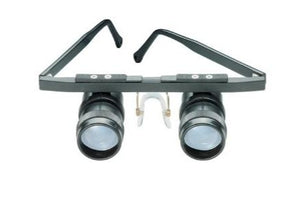 Small Galilean systems attached as eyepieces to a carrier frame