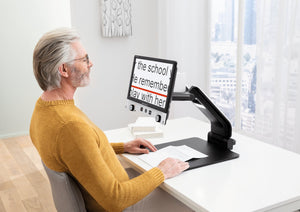 Man using Vario Digital FHD to read a document