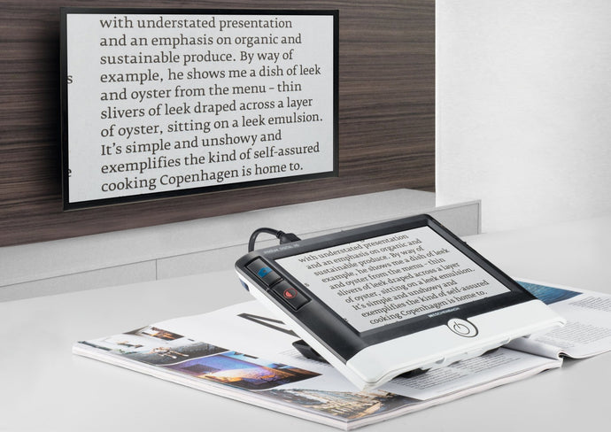 Visolux Digital HD being used to project a book onto a television