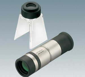 Handheld monocular with silver colour coating and black eyepiece, next to stand with eyepiece for converting monocular to stand magnifier or stand microscope
