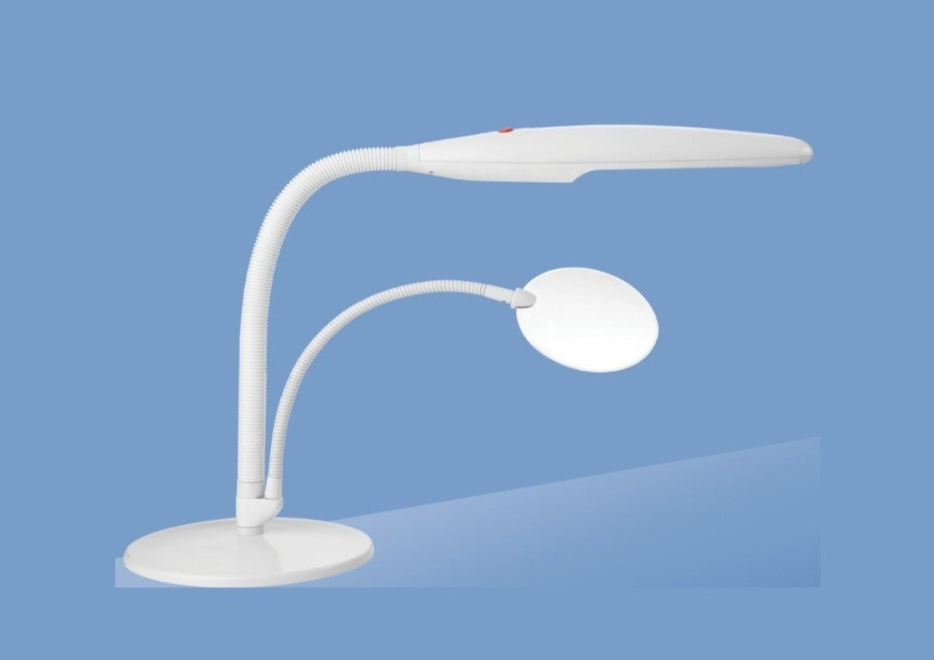 White Daylight lamp extended over a circular magnifier. Both magnifier and lamp on bendable necks and are attached to one circular white base