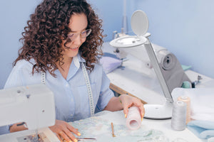 Woman using Halo-Go for sewing