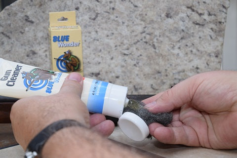 Apply Blue Wonder Gun Cleaner to 0000 steel wool to remove rust