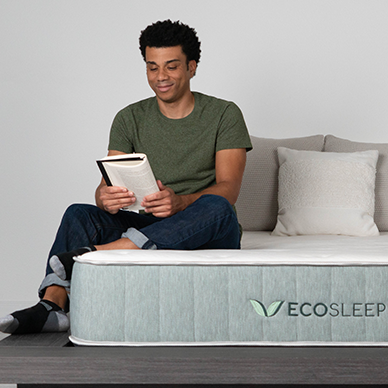 man reading on a bed