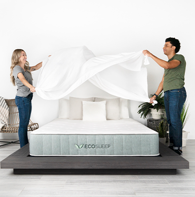 man and women making bed