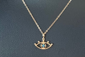 Yellow gold eye necklace