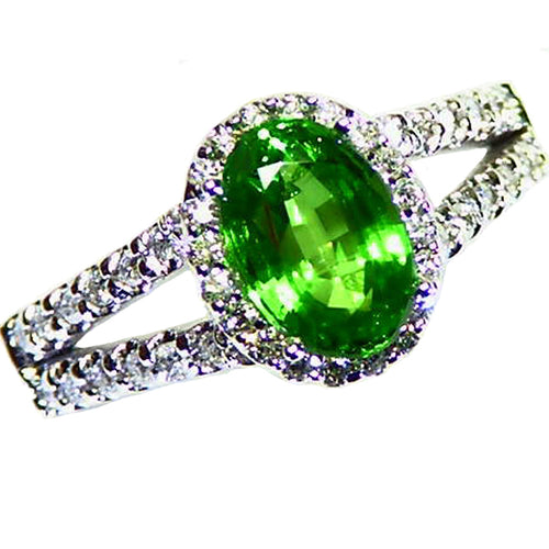 Bright green, natural tsavorite garnet diamond halo white gold ring