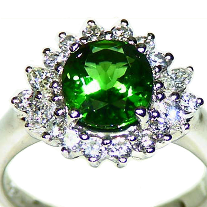 Gorgeous Tsavorite garnet with twinkling diamond halo platinum engagement ring